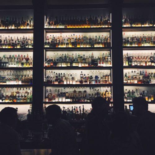 bottles-on-lit-up-shelves_t20_JlbV0P
